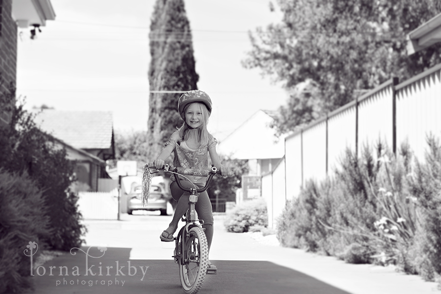 Girl riding her bike, happy days, child photography