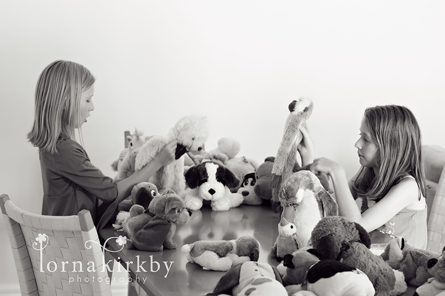 Girls play with old toys, child photography