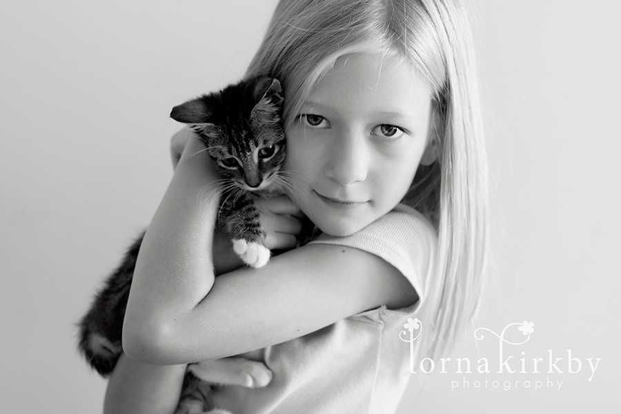 Jenna and her cat, Kitty Galore, child photography project