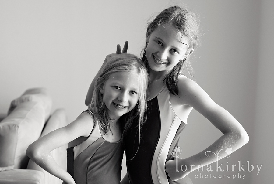 My girls swimming and goofing around together, child photography project