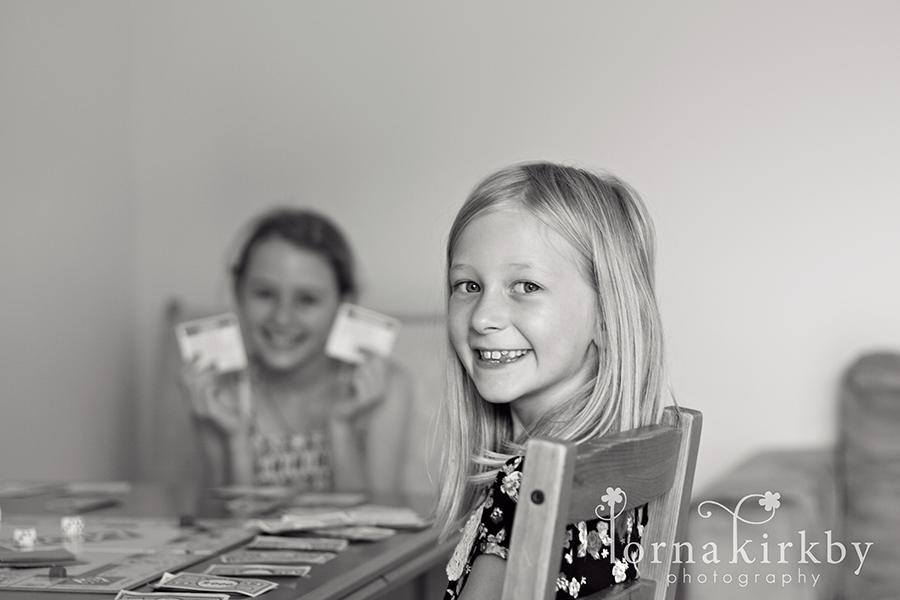 Hannah and Jenna battle it out on the Monopoly board, child photography
