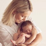 Picture of contented mother with newborn baby as part of Melbourne newborn photography session.