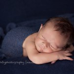 A picture of newborn boy in blue as part of Melbourne newborn photography session.