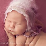 Picture of angelic newborn baby in pink by Melbourne newborn photographer, Lorna Kirkby.