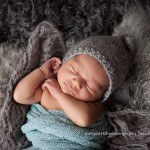 Photo of cuddly newborn boy stretching, Zach portfolio by Melbourne newborn photographer Lorna Kirkby