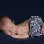 Picture of cute newborn baby boy in blue pants, Sammy by Melbourne newborn photographer, Lorna Kirkby Photography