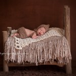 Image of sleeping newborn boy on bed, Sammy by Melbourne newborn photographer, Lorna Kirkby Photography