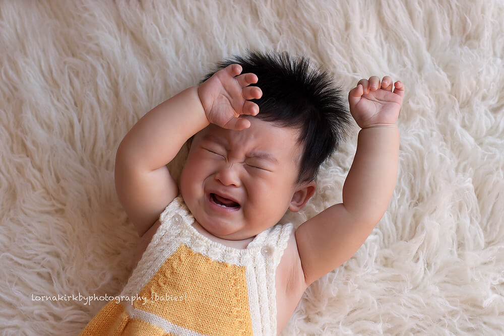 Pic of tired, not so happy baby boy from the Terry portfolio by Melbourne baby photographer, Lorna Kirkby