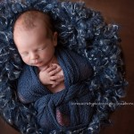 Photographic image of newborn baby boy wrapped in blue, Sammy by Melbourne newborn photographer, Lorna Kirkby Photography