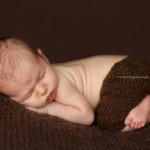 Image of beautiful newborn baby in brown from the Finn Collection by Lorna Kirkby, Melbourne newborn photography.