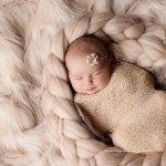 Image of newborn baby with delightful smile from the lady Genevieve collection by Melbourne newborn photographer, Lorna Kirkby.