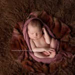 Image of a newborn girl in a brown from the Juliana portfolio in Melbourne newborn photography by Lorna Kirkby.