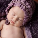 Picture of beautiful newborn baby in purple from Sienna portfolio by Melbourne newborn baby photographer Lorna Kirkby.