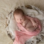 Image of a beautiful sleeping newborn girl is a dash of pink. From the Tayla Portfolio by Melbourne newborn and baby photographer, Lorna Kirkby. Lorna specialises in child, maternity, baby and newborn photography.