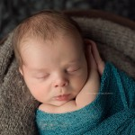 An image of a newborn boy showing the gains of digital photography.