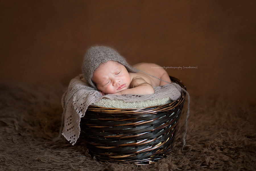 Photograph of a newborn baby in a basket