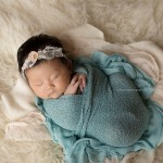 Beautiful baby wrapped in turquoise. Premier newborn photography, the Nicole Collection, Part 2.