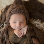 Custom newborn photography photo from the Pierre collection. An adorable newborn in brown.