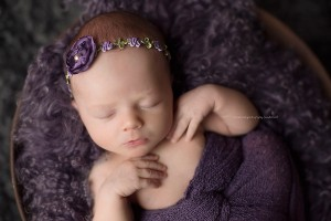 Beautiful newborn in purple for posing a newborn.