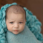 Seth poses in turquoise too for classic newborn photography.