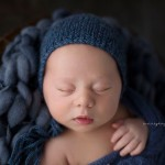 Gorgeous Rufus poses in blue for his newborn session.