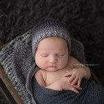 Peaceful Isaac sleeps for newborn photography mentoring.