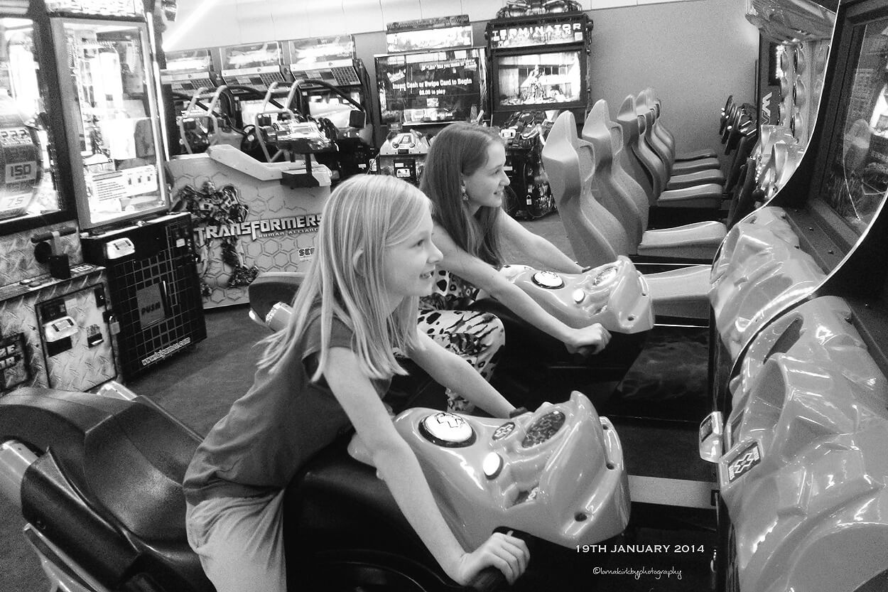 Picture of my girls having fun at the arcade on Day 19 of the photo-a-day challenge.