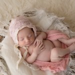 Tayla poses for newborn and baby sessions.