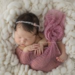 Pretty in pink, a newborn girls in photo session.