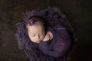 Image of Chloe cuddling for posed newborn photography.