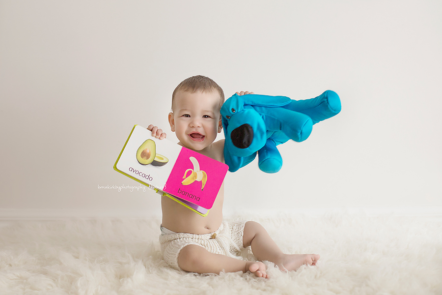 A photograph of Kaelan and his favourite toys during his photographic session.