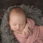 Stunning little Lily sleeps during her newborn photo session.